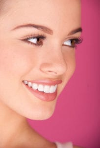 side profile of a woman smiling